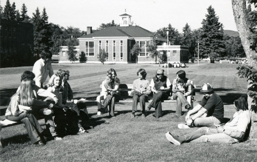 students sitting outside on the campus quad