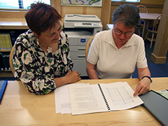 photo of Lise Pelletier, Director of the Acadian Archives acadiennes, with local genealogy expert Helen Melvin