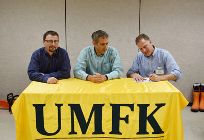 UMFK's Jeff Dubis sits next to representatives from the Saint John Valley Technology Center as they sign the articulation agreement