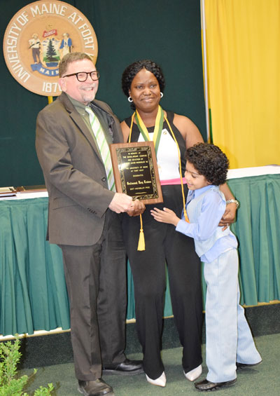 UMFK President Dr. John N. Short presented Orufonomoh Mary Trudeau, of Warri Delta State, Nigeria, the Haenssler Prize Award during the UMFK Senior Class Banquet and Awards Convocation held on Friday, May 12 at the UMFK Sports Center.