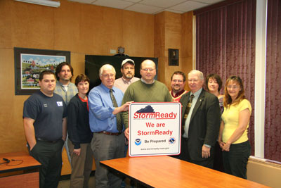 UMFK deemed StormReady (front l to r) Joshua Belanger, Leslie Kelly, John Murphy, Timothy Duda, Wilson Hess, and Lisa Fournier (back l to r) Arthur Drolet, Andrew Jacobs, Ray Phinney, and Tammy Connor.