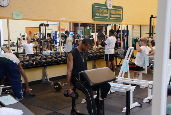 students using the weight room at the UMFK Sports Center