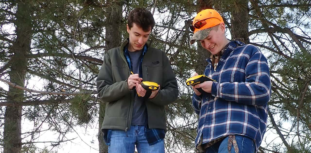 two UMFK students use GIS equipment