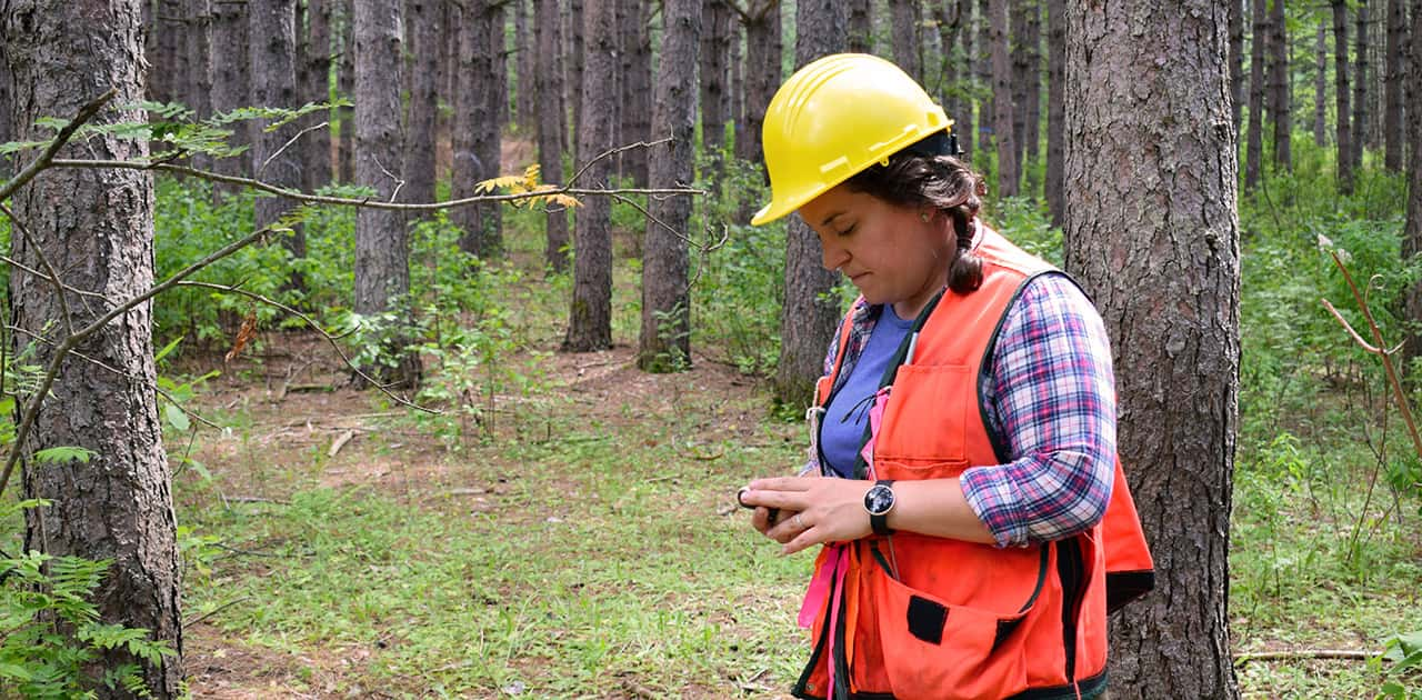 UMFK forestry professor uses a compass to find her way