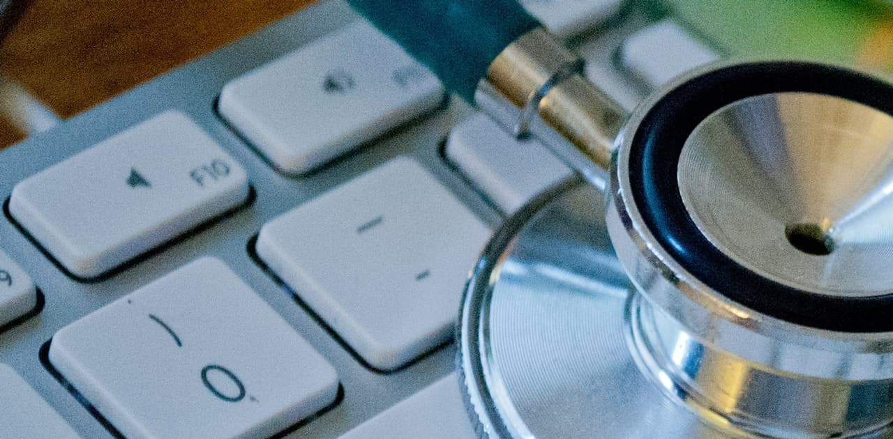 Stethoscope on top of a computer keyboard