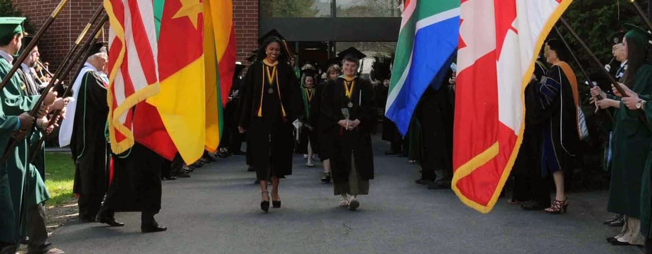 Graduates Walking Out Through the Flags